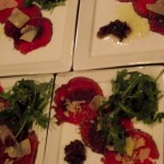 Carpaccio with arugala salad and olive tapenade