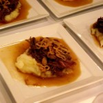 Guiness braised lamb with cauliflower mash and crispy shallots